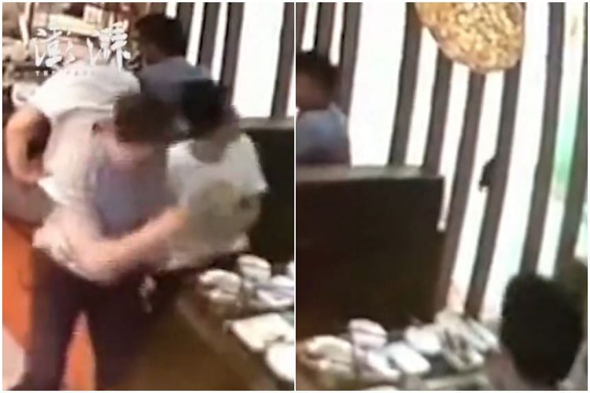 In a video circulating on Chinese social media sites, the four diners are seen leaping from their seats and away from their table at the Shenzhen restaurant, after a rat scurried down from the ceiling.