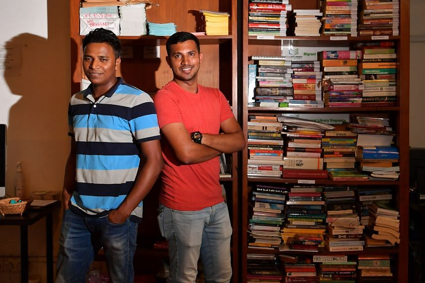Book lovers Fazley Elahi Rubel (in red T-shirt) and A. K. Zilani, together with Mr Ripon Chowdhury (not in picture), set up a library for migrant workers.