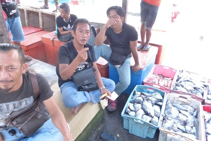 The rising cost of living is an issue for voters like fisherman Abdul Ghafar Radin (centre) in Sabah. Some political analysts based there believe former Umno vice-president Shafie Apdal has an even chance of overthrowing the Umno-led state government