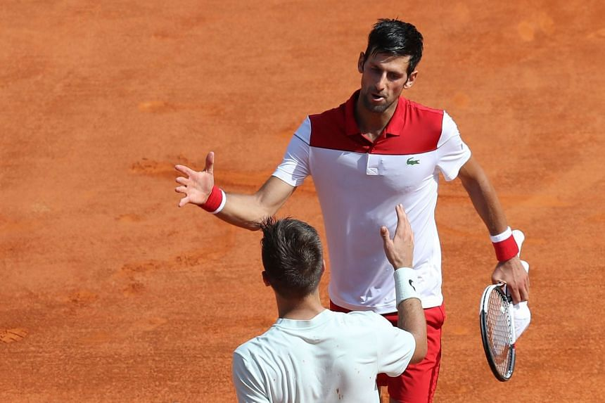 Djokovic shaking hands with Croatia's Borna Coric after winning their Monte Carlo Masters match.