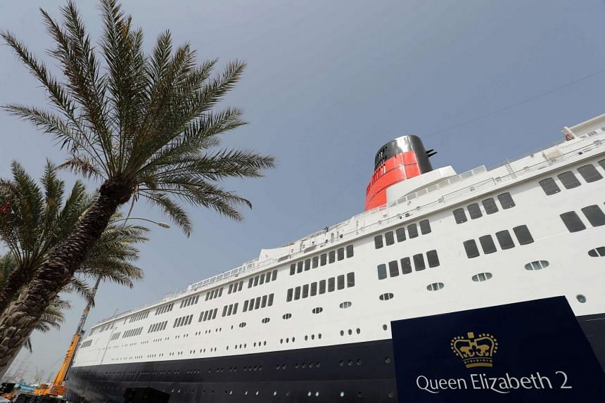 The Queen Elizabeth II luxury cruise liner, also known as the QE2, is seen docked at Port Rashid in Dubai.