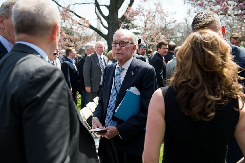 Kudlow (above, centre) says the US would like to reach a separate free-trade deal with Japan.