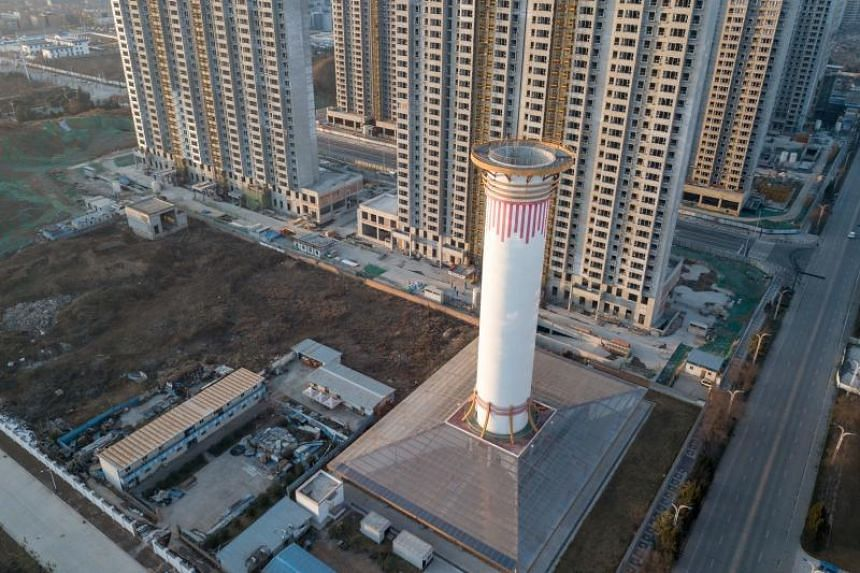 Instead of pumping out billows of black smoke, the giant air purifier on the outskirts of Xian blasts clean air.