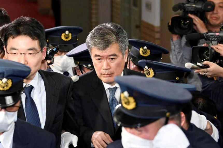 Japan's Administrative Vice-Finance Minister Junichi Fukuda leaving the ministry in Tokyo, on April 16, 2018.