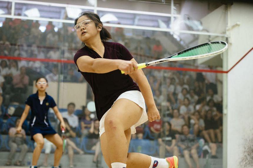 Monica Lim (front), 16, of Singapore Chinese Girls' School (SCGS) plays the deciding match against Methodist Girls' Hazel Chua.