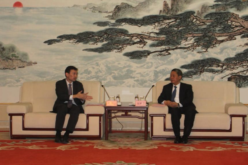 Senior Minister of State for Communications and Information and Health Chee Hong Tat (left) meeting Yantai Party Secretary Zhang Shuping in Yantai, China.