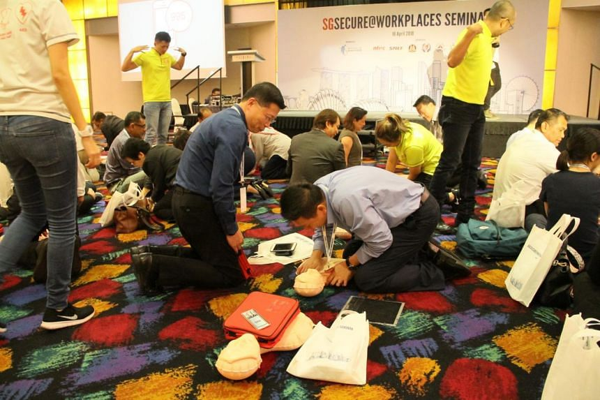 A CPR training session being conducted at the annual SGSecure@ Workplace Seminar at Furama City Centre on April 18, 2018.