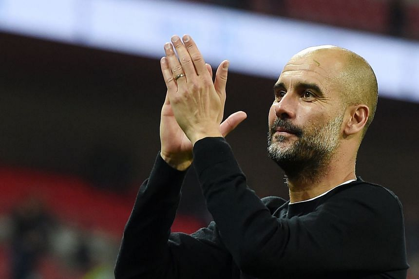 City TV released footage of Guardiola (above) addressing the club's staff.