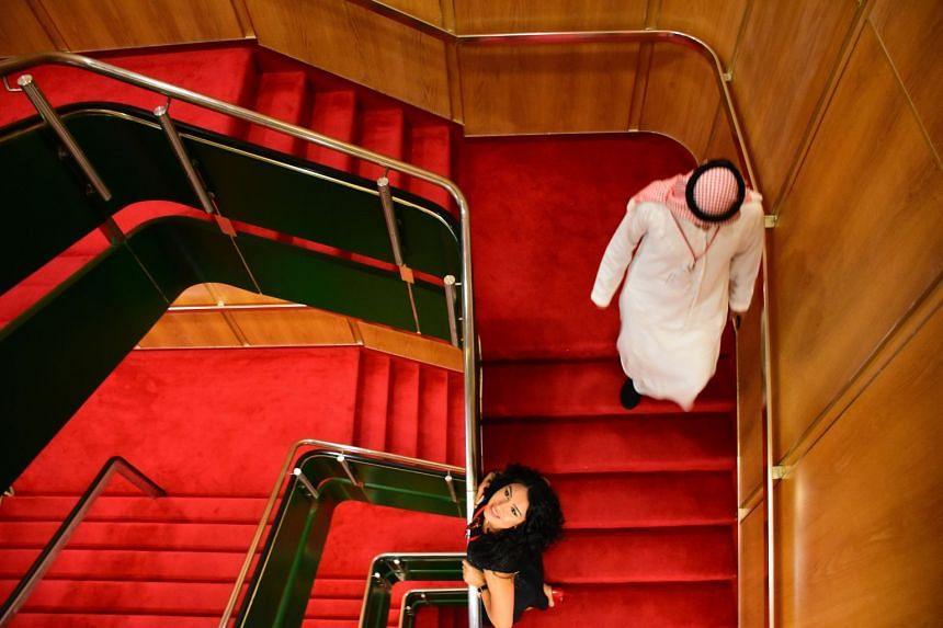 Visitors walk through a deck of the legendary Queen Elizabeth II, also known as QE2.