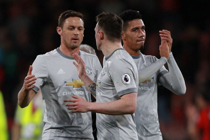 United's Nemanja Matic, Phil Jones and Chris Smalling celebrate after the match.