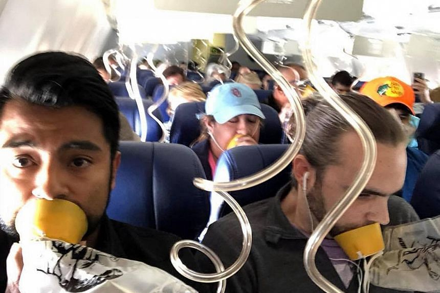 Passengers on board the Dallas-bound Southwest Airlines flight from New York, which made an emergency landing. After an engine on the plane's left side blew, it threw off shrapnel, shattering a window and causing cabin depressurisation that nearly pu