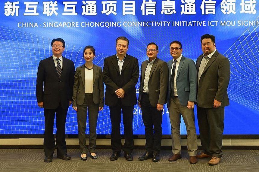 From left: Mr Peng Zhi Ming, vice-director of China-Singapore (Chongqing) Demonstration Initiative on Strategic Connectivity Administration Bureau (CCIB); SocialCredits co-founder Chen Wei, CCIB director-general Han Bao Chang, IMDA CEO Tan Kiat How,