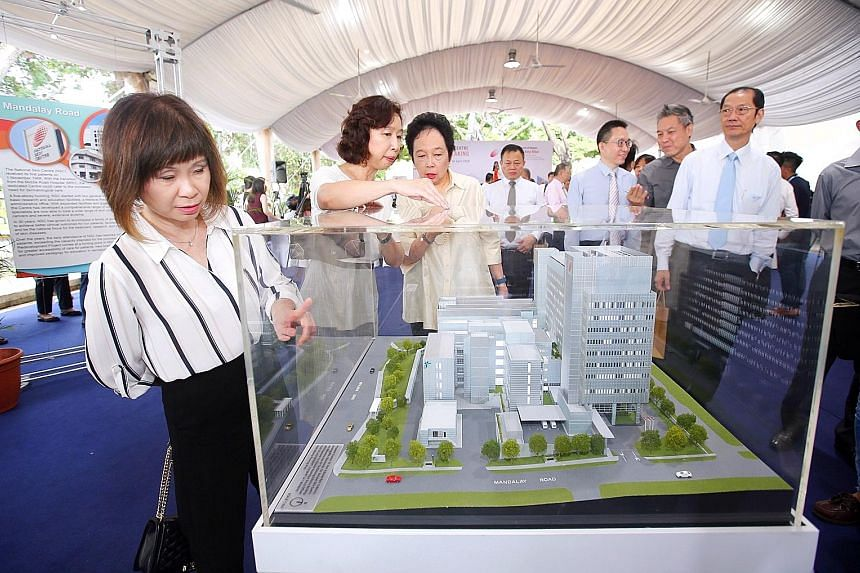 From left: Senior Minister of State for Health Amy Khor, National Skin Centre director Tan Suat Hoon and National Healthcare Group chairman Kay Kuok checking out a model of the new NSC building at the groundbreaking ceremony.