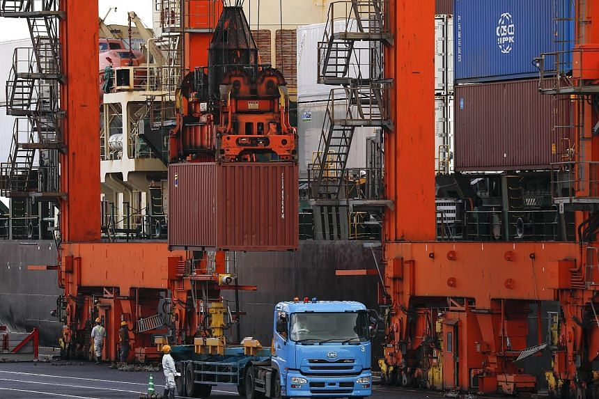 An international cargo terminal in Tokyo. Data out yesterday showed Japan's shipments last month grew 2.1 per cent from the same period a year ago, below the 4.7 per cent annual increase expected by economists in a Reuters poll. In February, exports