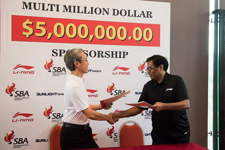 Tan Kian Chew, president of the Singapore Badminton Association, with Mahender Kapoor, managing director of Li-Ning distributor Sunlight Sports. Li-Ning, a sports apparel and equipment maker, has extended its sponsorship of the association until 2022