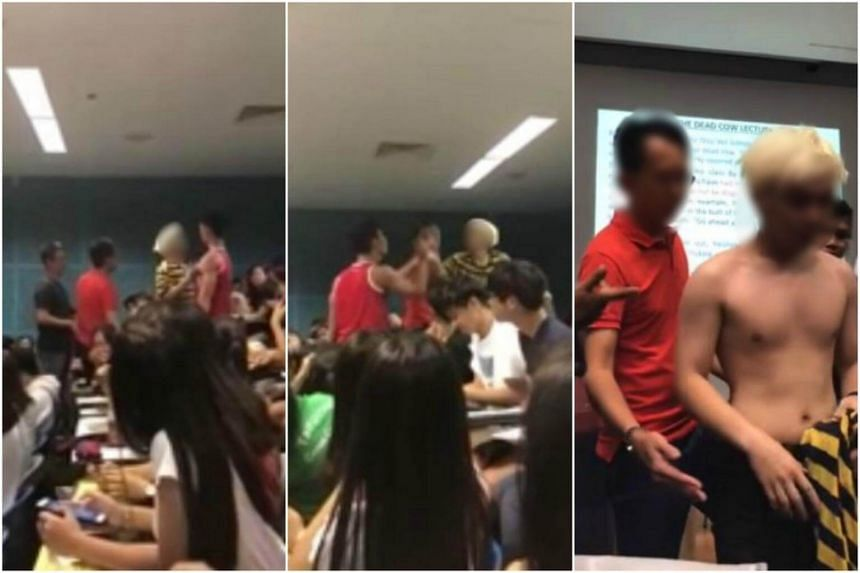 As a lecturer tries to stop the scuffle, the student in the yellow and black striped shirt continues on his tirade, hurling vulgarities and gesturing at several students.