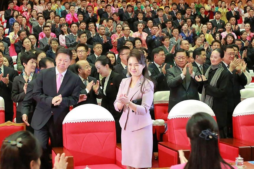 North Korean first lady and wife of Kim Jong Un, Ri Sol Ju (front centre), attending the ballet choreodrama Giselle given by the National Ballet of China during the 31st April Spring Friendship Art Festival at the Mansudae Art Theatre in Pyongyang.