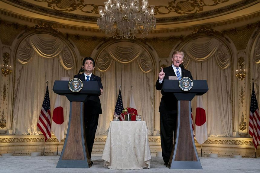 President Donald Trump and Japanese Prime Minister Shinzo Abe holding a joint news conference at the Mar-a-Lago resort.