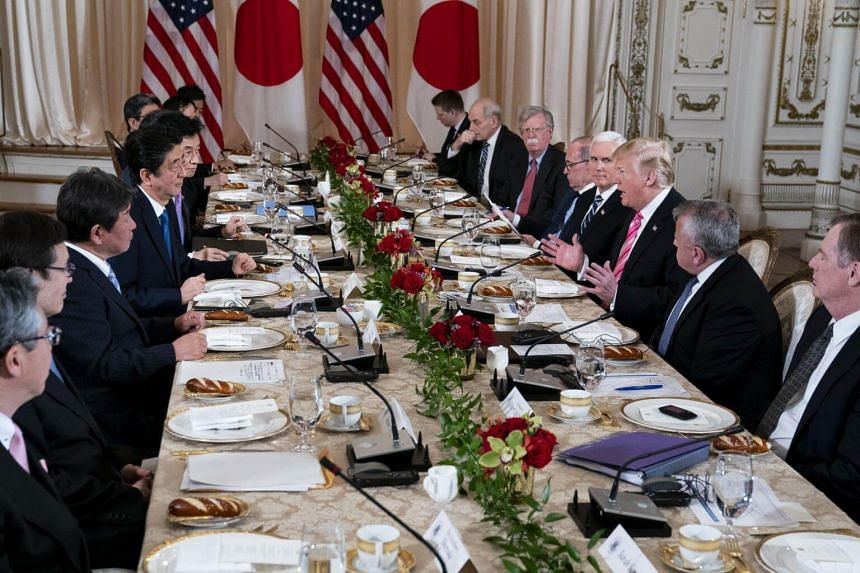 President Donald Trump speaks during a working lunch with Japanese Prime Minister Shinzo Abe at Mar-a-Lago on April 18, 2018.