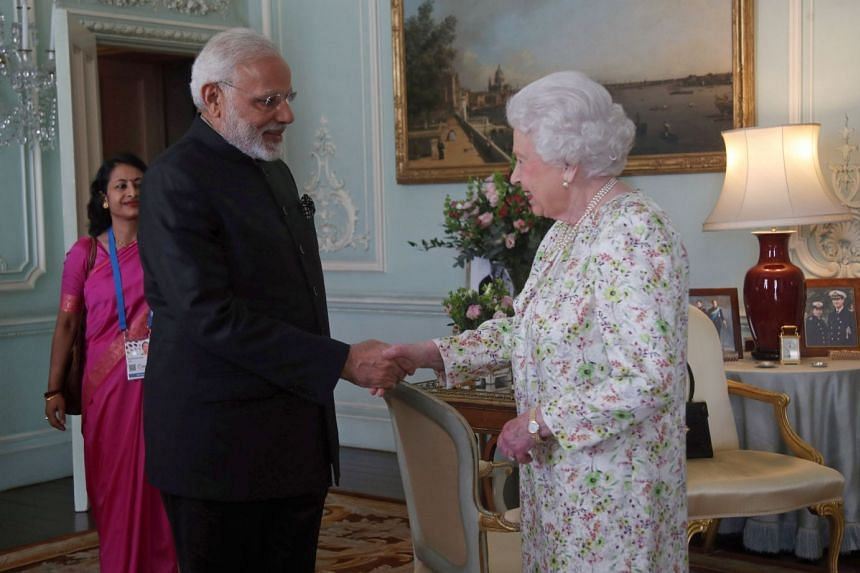 Modi is greeted by Britain's Queen Elizabeth II during a private audience at Buckingham Palace on April 18, 2018.