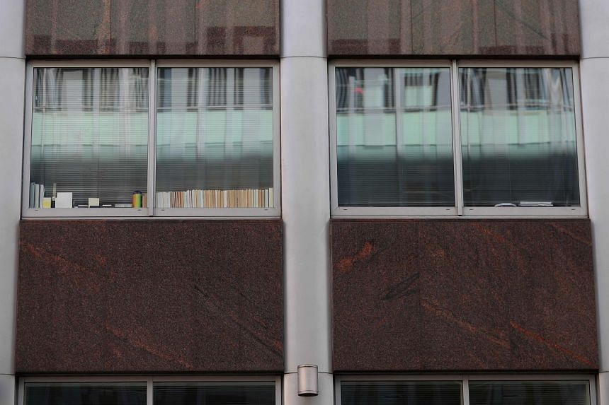 """Windows, one with the words """"Data"""", """"Digital"""", and """"Regulations?"""" (left) are pictured on the second floor of a building which houses the offices of Cambridge Analytica, in central London."""