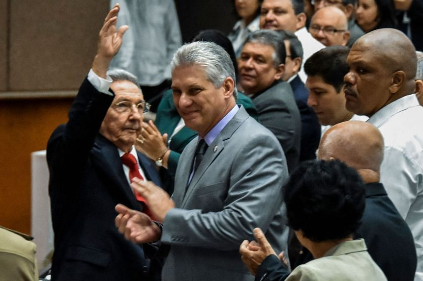 Castro (left) gestures next Diaz-Canel (centre) during the National Assembly session on April 18, 2018.