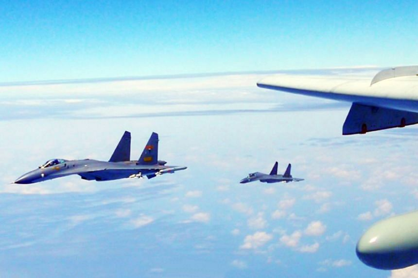 """Chinese aircraft flown around Taiwan in what China's air force called a """"sacred mission"""" on April 19, 2018."""