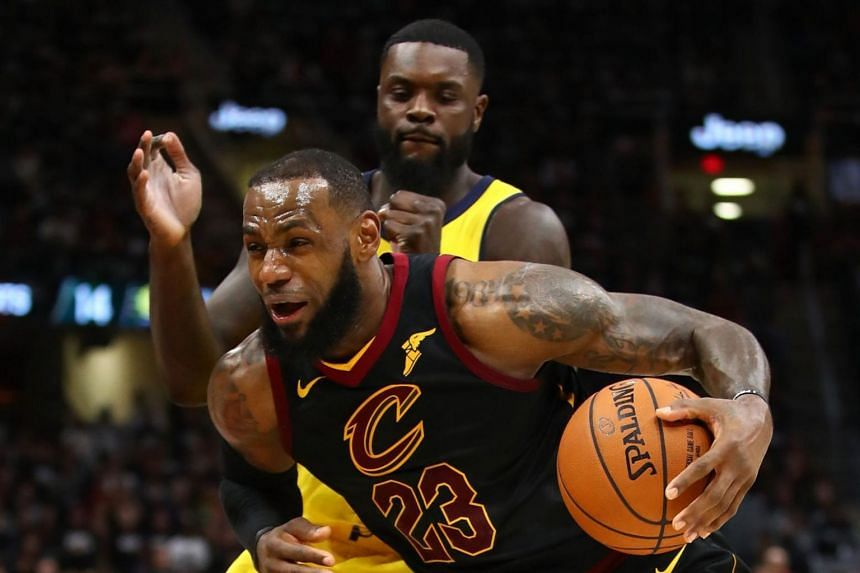 LeBron James of the Cleveland Cavaliers dribbling the ball past Lance Stephenson of the Indiana Pacers.