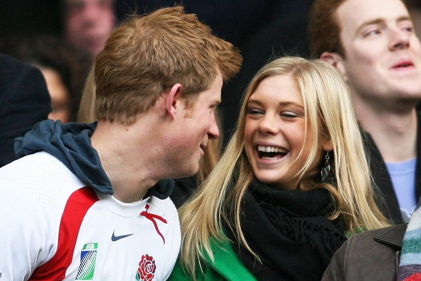 File photo of Britain's Prince Harry and his ex-girlfriend Chelsy Davy during a game between South Africa and England at the Investec Challenge international rugby match at Twickenham, west of London.