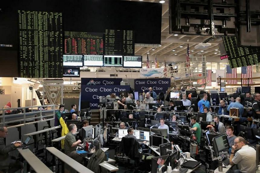 Traders trade VIX contracts at the Cboe Global Markets exchange in Chicago, Illinois on Dec 19, 2017.