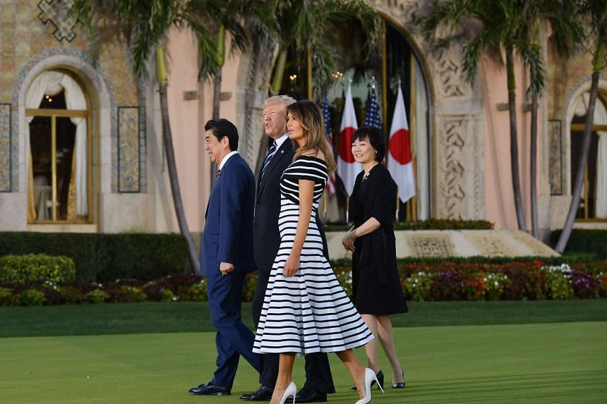 US President Donald Trump and First Lady Melania Trump with Japanese Prime Minister Shinzo Abe and his wife, Mrs Akie Abe, as they arrived for dinner at Mr Trump's Mar-a-Lago resort in Palm Beach, Florida, on Tuesday. In a meeting between the two lea