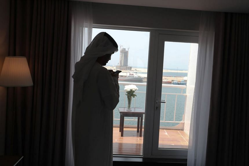A man visits a duplex suite on The Queen Elizabeth II luxury cruise liner.