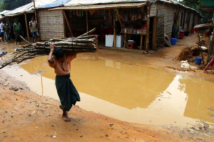 Pools of water at a refugee camp for Rohingya refugees in Bangladesh's Cox's Bazar district following rains ahead of the monsoon season on April 19, 2018.
