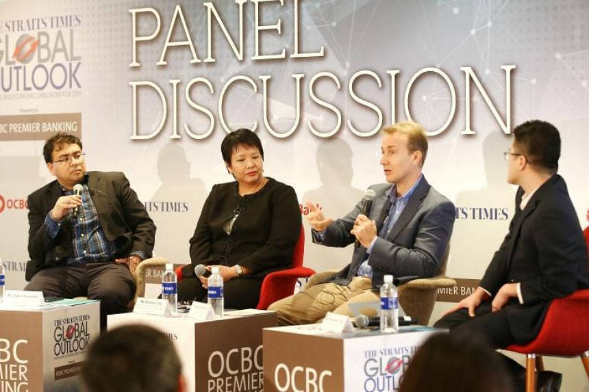 (From left) The Straits Times' foreign editor Zakir Hussain, OCBC Bank Head of Treasury Research & Strategy Selena Ling, ISEAS - Yusof Ishak Institute Senior Fellow and Coordinator of Malaysia Studies Programme, Dr Francis Hutchinson, and ST Malaysia