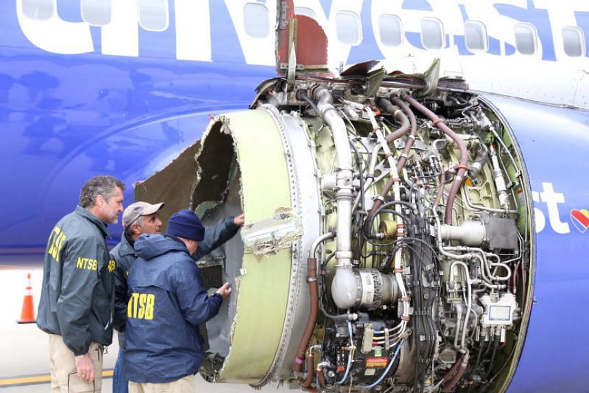 US NTSB investigators examining the damage to the engine of the Southwest Airlines plane in Pennsylvania, US on April 17, 2018.