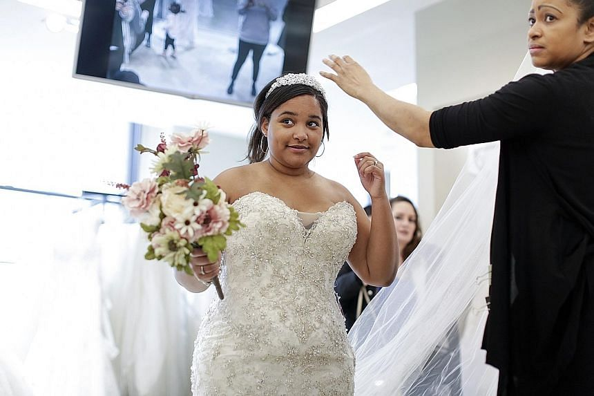 Full-size brides such as Ms Josefina Rodriguez now have more wedding dress choices.