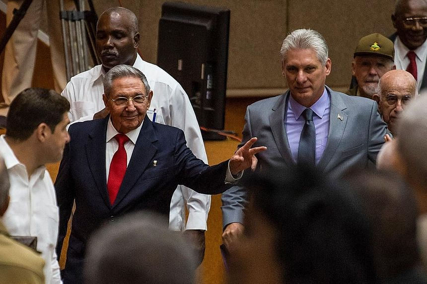 Outgoing Cuban President Raul Castro (left) and First Vice-President Miguel Diaz-Canel are shown arriving at the National Assembly yesterday in a photo by official Cuban website www.cubadebate.cu.