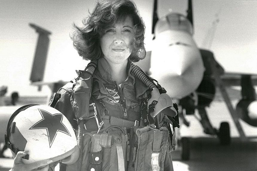 """Lieutenant Tammie Jo Shults with her F/A-18 jet in 1992. One Flight 1380 passenger called her """"a true American hero"""" and another praised her for having """"nerves of steel"""" in landing the stricken plane safely."""