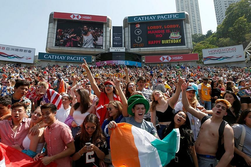 Fans in the south stand of the Hong Kong Stadium singing in unison during the Hong Kong leg of the World Rugby Sevens Series earlier this month. World Rugby chief executive Brett Gosper says the HSBC Singapore Rugby Sevens has the potential to match