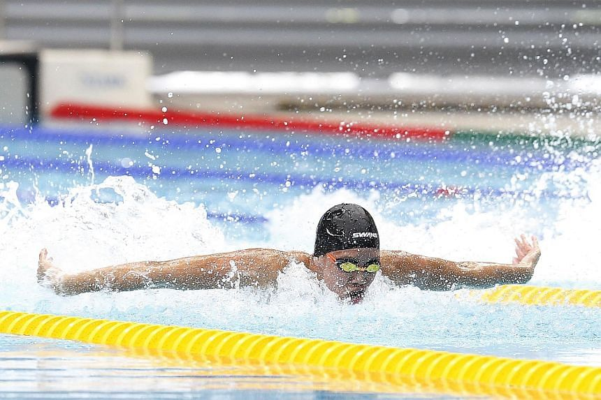Mikkel Lee of Anglo-Chinese School (Independent) on his way to equalling his personal best and setting a meet record of 24.73sec in the B Division 50m butterfly final at the OCBC Aquatic Centre yesterday.