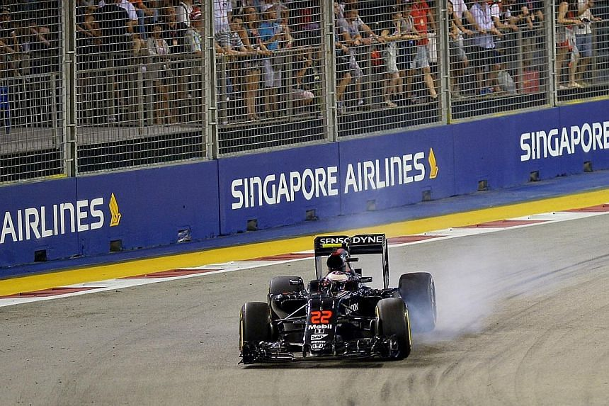Jenson Button during the first practice session of the 2016 Formula One Singapore Airlines Singapore Grand Prix. SIA first came on board as title sponsor of the night race in 2014. The airline has never revealed the price tag for the deal, but it is