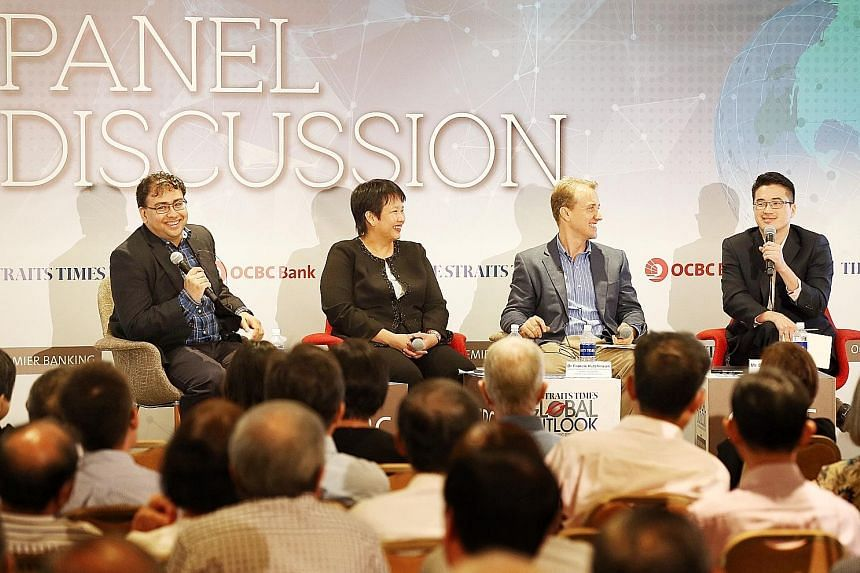 (From left) The Straits Times' foreign editor Zakir Hussain, who was the moderator, with OCBC Bank's Ms Selena Ling, ISEAS - Yusof Ishak Institute's Dr Francis Hutchinson and ST's Malaysia bureau chief Shannon Teoh at yesterday's ST Global Outlook Fo