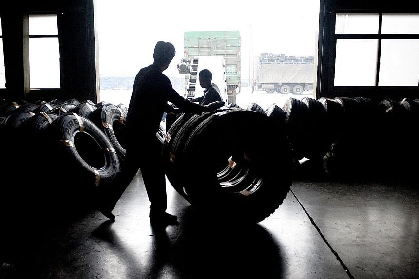 A tyre factory in Shandong province, China. The country's anti-dumping move comes amid a trade spat with the US. German petrochemical giant Lanxess' butyl rubber plant on Jurong Island. China's rubber duties could affect global firms operating synthe