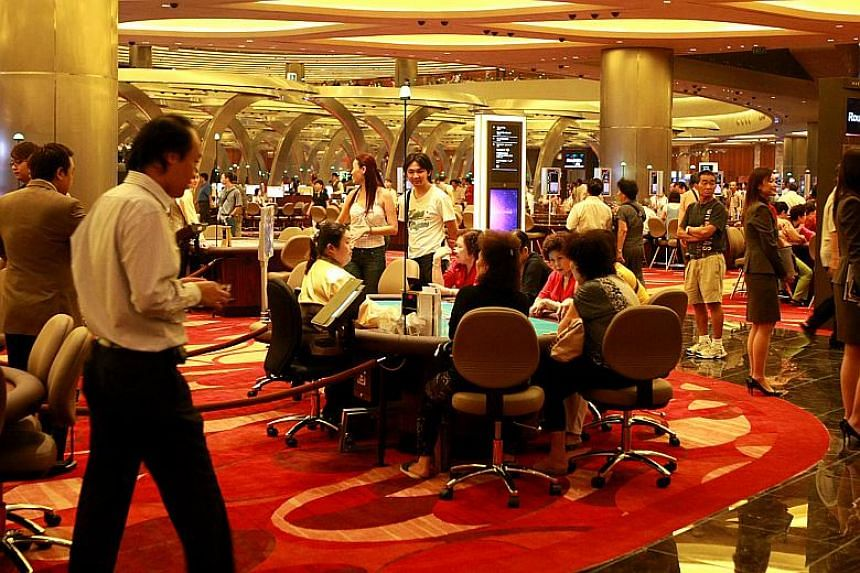 A crowd filling up the casino in Marina Bay Sands.