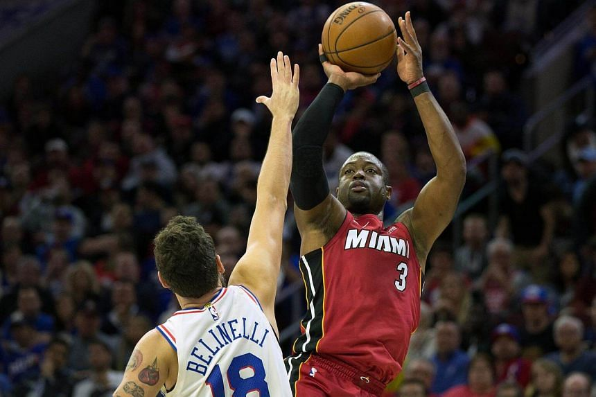 Miami Heat guard Dwyane Wade shoots over Philadelphia 76ers guard Marco Belinelli during the second quarter in game two of the first round of the 2018 NBA Playoffs, on April 16, 2018.