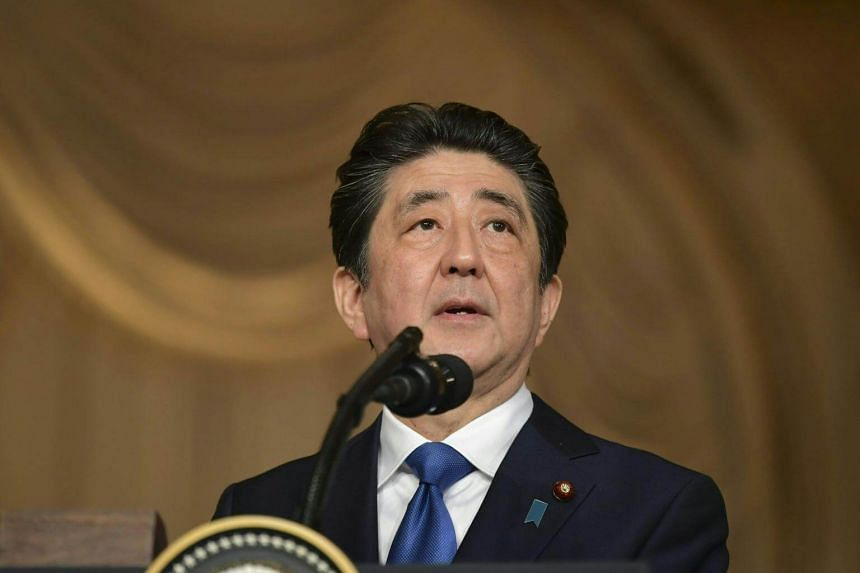 Japan's Prime Minister Shinzo Abe speaks during a joint press conference at Mar-a-Lago estate in Palm Beach, Florida, on April 18, 2018.