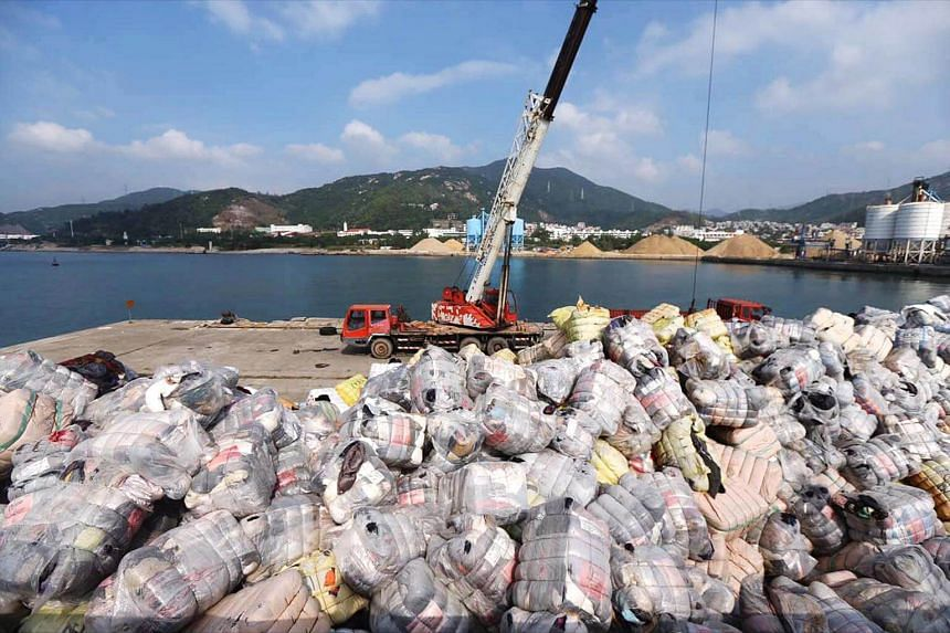 Shenzhen Customs destroying illegally imported waste during a raid at a port in Shenzhen, China, on Nov 17, 2016. China's State Council has released a list of 24 banned types of solid waste, including plastics, in a reform plan.