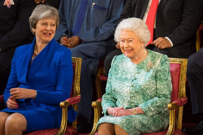 Britain's Prime Minister Theresa May (left) smiles with Queen Elizabeth at the formal opening of the Commonwealth Heads of Government Meeting.