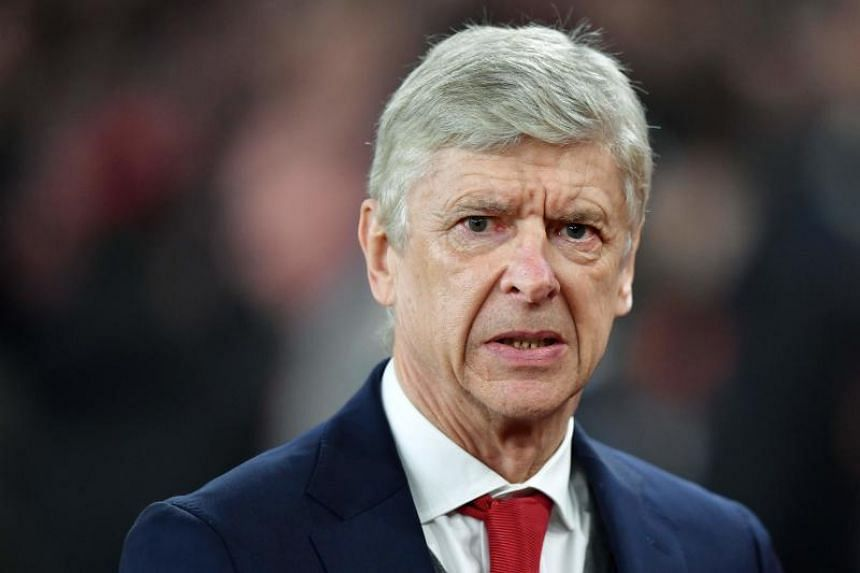 Arsenal's French manager Arsene Wenger looks on before the UEFA Europa League round of 16 second-leg football match between Arsenal and AC Milan at the Emirates Stadium in London on March 15, 2018.