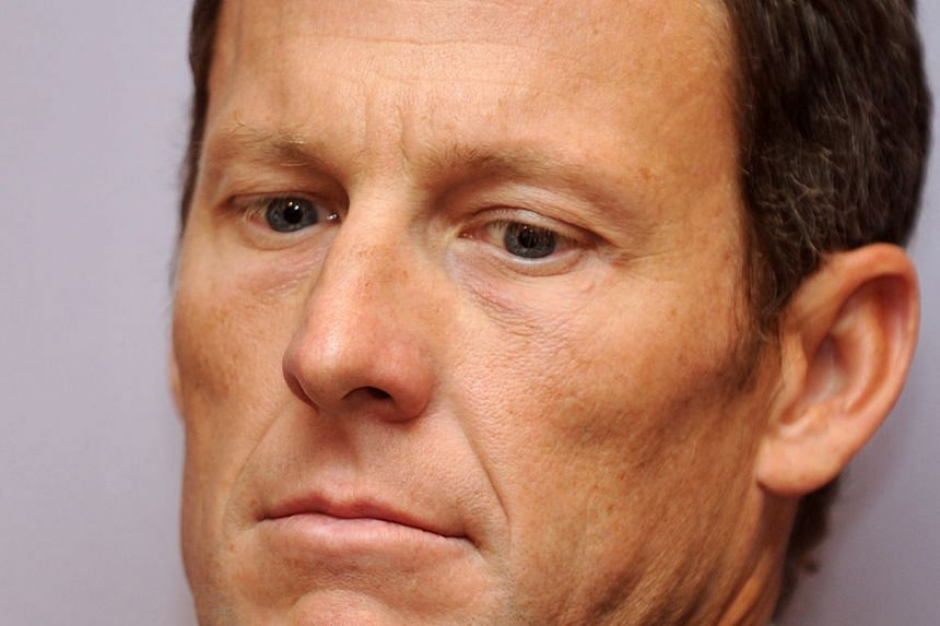 Armstrong (above, in 2011) has agreed to pay US$5 million to settle his looming federal fraud case.